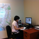 SAIL Intake Worker, Lin Chen, answering the Seniors Abuse and Information Line.